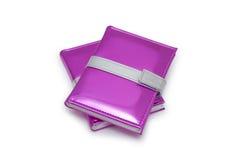 Libros rosados aislados en el fondo blanco Foto de archivo