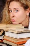 Libros y cara foto de archivo libre de regalías