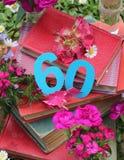 Libros y flores para un sixtieh birhday Fotos de archivo