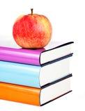 Libros y manzana Fotografía de archivo libre de regalías