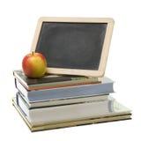 Libros y manzana de escuela Imagen de archivo libre de regalías