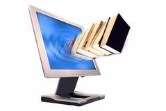 Libros y monitor Imagenes de archivo