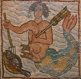 Libya Cyrenaica Byzantine mosaic. Libya Cyrenaica Qsar ancient well preserved Byzantine mosaic depicting a merman catching a fish royalty free stock photo