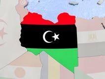 Libya with flag on globe Royalty Free Stock Images