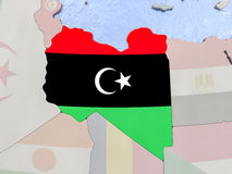 Libya with flag on globe Stock Images