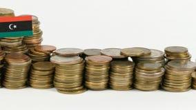 Libya flag with stack of money coins. Libya flag waving with stack of money coins stock footage