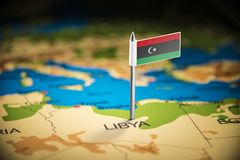 Libya marked with a flag on the map.  stock photos