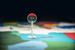 Libya marked with a flag on the map.  stock images