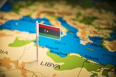 Libya marked with a flag on the map.  royalty free stock photos