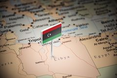 Libya marked with a flag on the map.  royalty free stock image