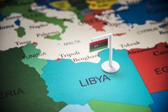 Libya marked with a flag on the map.  royalty free stock photo