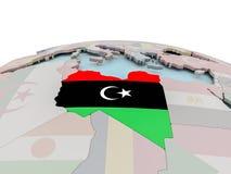 Political map of Libya on globe with flag Stock Photos