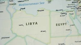 Libya on a map with defocus. Libya on a political map of the world. Video defocuses showing and hiding the map stock video