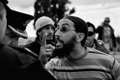 Libyan Embassy Protest. ATTARD, MALTA - FEB 22 - A Libyan anti-Gaddafi protester speaks with Malta Police during a protest in front of the Libyan Embassy in Stock Images