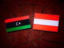 Libyan flag with Austrian flag on a tree stump  Royalty Free Stock Photo