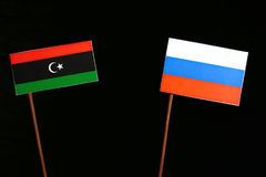 Libyan flag with Russian flag isolated on black Stock Image