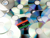 Libyan flag on top of CD and DVD pile isolated on white Royalty Free Stock Photo