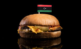Libyan flag on top of hamburger isolated on black Royalty Free Stock Images