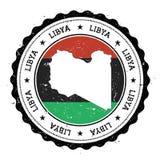 Libyen översikt och flagga i den rubber stämpeln för tappning av Royaltyfri Bild