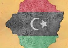 Libyen flaggaabstrakt begrepp i betongvägg för agg för fasadstruktur stor skadad royaltyfri fotografi
