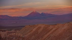 Licancabur high volcano time lapse with full moonrise at sunset with pink sky stock video footage