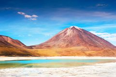 Licancabur volcano and Laguna Verde in Altiplano, Bolivia. Licancabur volcano and Green lagoon Laguna Verde on plateau Altiplano, Bolivia Royalty Free Stock Photos