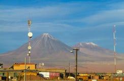Licancabur volcano above the city of San Pedro de Atacama, Chile. Licancabur volcano in San Pedro de Atacama desert, Chile. Ancient volcano crater from far Stock Photo