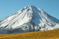 Licancabur volcano. Snow-covered Licancabur volcano viewed from Paso de Jama, Chile Stock Photos