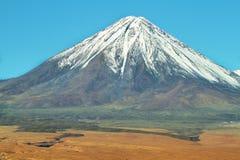 Licancabur volcano. Snow-covered Licancabur volcano viewed from Paso de Jama, Chile Royalty Free Stock Photo