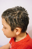 Lice shampoo on young boy. Profile of young boy being shampooed to treat lice infestation Royalty Free Stock Photos