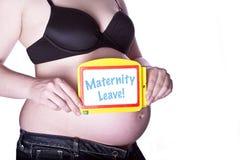 Licenças de parto grávidas do sinal Imagens de Stock