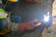 Licence welder weld bore pile auger at construction site Stock Images