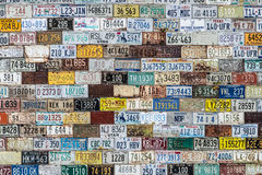 License plate background texture pattern wall. Wall at historic ghost town - one of the top tourist attractions in central Colorado. old vintage license plate stock photo