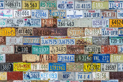 License plate background texture pattern wall. Old vintage license plate background texture pattern wall made from discarded license plates from multiple states royalty free stock photo