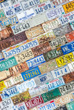 License plate background texture pattern wall. Old vintage license plate background texture pattern wall made from discarded license plates from multiple states royalty free stock images