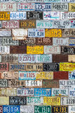 License plate background texture pattern wall. Old vintage license plate background texture pattern wall made from discarded license plates from multiple states royalty free stock photography