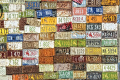 License plates. Wall of old forgotten License plates Stock Image