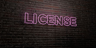 LICENSE -Realistic Neon Sign on Brick Wall background - 3D rendered royalty free stock image Stock Photo