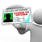 License to Succeed - Man Holding Badge Stock Photo