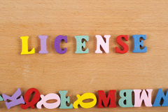 LICENSE word on wooden background composed from colorful abc alphabet block wooden letters, copy space for ad text. Learning english concept royalty free stock photography