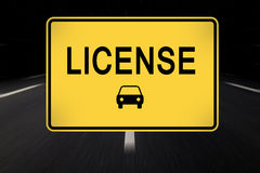 License. Written on a traffic sign Royalty Free Stock Photos