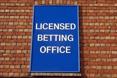 Licensed betting office sign. Sign directing to a licensed betting office or gambling royalty free stock image