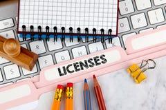 Licenses concept. Folder Register on Background of Computer Keyboard.  stock images