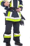 Lichaam van een brandweerman die zijn eenvormig en toestel tonen Royalty-vrije Stock Afbeeldingen