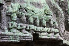 Lichen-covered carvings near Angkor Wat in Siem Reap, Cambodia Stock Photos