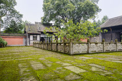 Lichen-covered flagstone yard of ancient Chinese building Stock Image