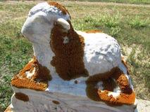 Lichen-covered lamb headstone. At Tompkins Saskatchewan Royalty Free Stock Photography