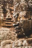 Lichen-covered Stone Head Statues Looking Across Each Othein Angkor Wat, Siem Reap, Cambodia, Indochina, Asia - face on in colour. Stone heads at different royalty free stock photos