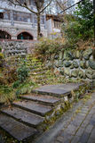 Lichen-covered stone stairway Stock Photo