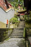 Lichen-covered stone steps between ancient Chinese buildings on Royalty Free Stock Photos